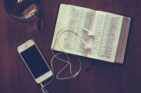 Bible with iPhone, earbuds and tea