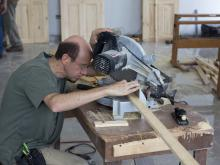 Tom using a saw