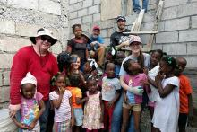 Team members with Haitian children