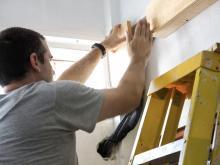 John working up a ladder