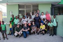 Team members with Haitian students after soccer