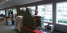 Boxes stacked high with a smile