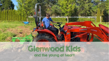 Boy on tractor plowing a field