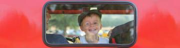 Boy peering out a car window