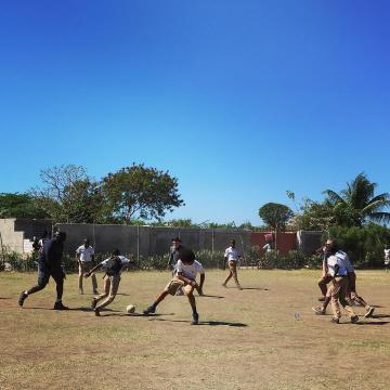 team playing soccer with the kids in merger