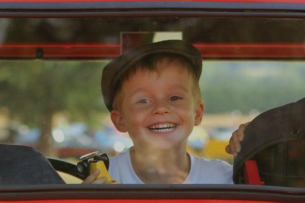Boy peering out a car window